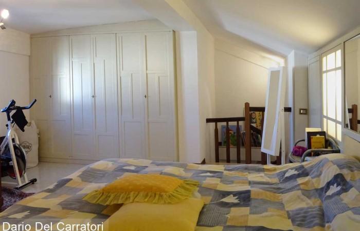 camera-matrimoniale-con-armadio-a-muro
